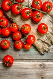 Ripe tomatoes on a cutting Board. On wooden background stock photos