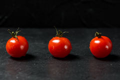 Ripe tomatoes on dark background Royalty Free Stock Photography