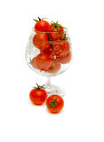 Ripe tomatoes in a glass. Red tomatoes in a glass on a white background Royalty Free Stock Image