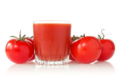 Ripe tomatoes and glass of tomato juice Royalty Free Stock Image