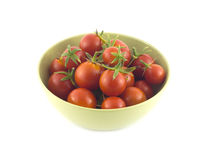 Ripe tomatoes in green bowl closeup isolated Stock Image