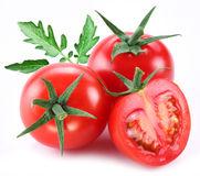 Ripe tomatoes with green leaf. Royalty Free Stock Photos