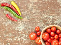 Ripe tomatoes and hot chilli peppers stock photography