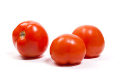 Ripe tomatoes isolated on white Stock Photography