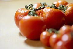 Ripe of tomatoes on kitchen table Stock Photos
