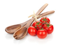 Ripe tomatoes and kitchen utensils Stock Images