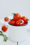 Ripe tomatoes in metal bowl with copy space on white background Royalty Free Stock Photos