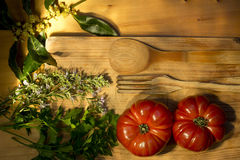 Ripe tomatoes, parsley, bay leaf and rosemary Royalty Free Stock Photo