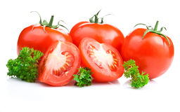 Ripe Tomatoes and parsley leaves Royalty Free Stock Images