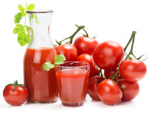 Ripe tomatoes and tomato juice Royalty Free Stock Photos