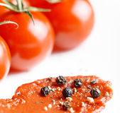 Ripe tomatoes and tomato paste Stock Images