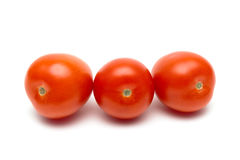 Ripe tomatoes on a white background close-up. Royalty Free Stock Photography