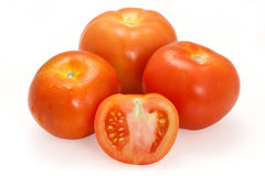 Ripe Tomatoes on White with Clipping Path. Ripe red tomatoes on a white background with clipping path. The focus is on the sliced tomato in front Stock Images