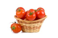 Ripe tomatoes in a wicker basket Stock Photo