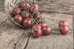 Ripe tomatoes on wooden table Royalty Free Stock Photos