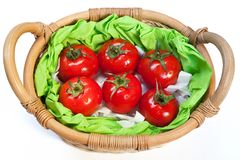 Ripe tomatoes in the woven basket Stock Images