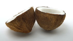 Ripe tropical coconut split in two halves rotating on white background. Looping exotic fruits. 00461 stock footage