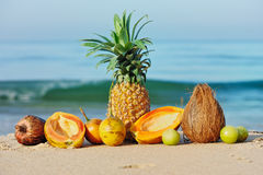 Ripe tropical fruit. Exotic tropical fruit on the sandy shore Royalty Free Stock Photo