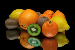 Ripe tropical fruits close-up on a black background Royalty Free Stock Photo