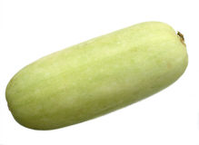 Ripe vegetable marrow. Fresh vegetable marrow on a white background a close up Royalty Free Stock Images