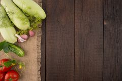 Ripe vegetables on an old wooden table. Royalty Free Stock Photo