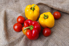 Ripe vegetables on rustic cloth. Tomatoes and bell-peppers on a rustic jute cloth Royalty Free Stock Photos