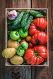 Ripe vegetables in wooden box Royalty Free Stock Photo