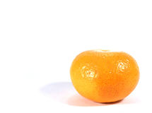 Ripe vivid color orange isolated on white background. Close-up of one ripe vivid color orange isolated on white background stock images
