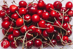 Cherries on the table. Ripe washed cherry on a white table, fresh harvest Royalty Free Stock Images