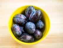 Ripe plums in plate Royalty Free Stock Image