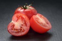 Ripe washed tomatoes on slate background Stock Photography