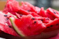 А ripe watermelon with black seeds sliced. Close-up. Royalty Free Stock Photos