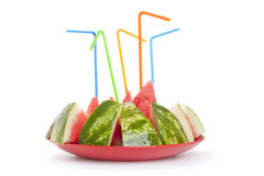 Ripe watermelon to pieces with a tubule on the plate Royalty Free Stock Image