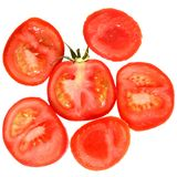 Ripe wet cut tomato close up isolated. On a white background Royalty Free Stock Image