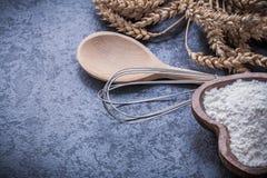 Ripe wheat rye ears wooden spoon bowl flour egg whisk Stock Images