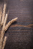 Ripe wheat rye ears on wooden vintage board food Royalty Free Stock Photo