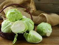 Ripe white cabbage. On a wooden table royalty free stock photo