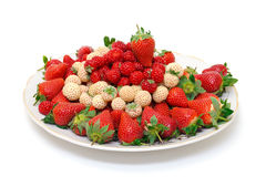 Ripe White and Red Strawberries on plate. White background Stock Images