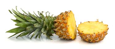 Ripe whole and half pineapple on white. Pineapple whole and half on white background stock image