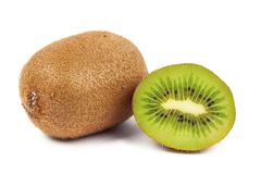 Ripe whole kiwi fruit and half kiwi fruit isolated on white background. Green juicy food sweet healthy part closeup cutout exotic fresh raw slice tropical royalty free stock photos