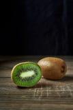 Ripe whole kiwi fruit and half kiwi fruit Royalty Free Stock Images