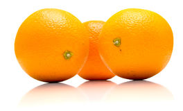 Ripe whole oranges. The ripe whole oranges covered by drops of a water. Isolation on white, shallow DOF Stock Image