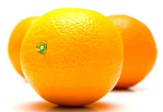 Ripe whole oranges. The ripe whole oranges on white, shallow DOF. Isolation Royalty Free Stock Photos
