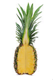 Ripe whole pineapple with a quarter cut Stock Photos