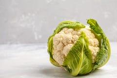 Ripe whole raw cauliflower on a light background on a napkin. Stock Photography
