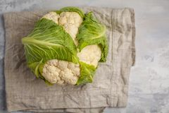 Ripe whole raw cauliflower on a light background on a napkin.  Stock Image