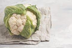 Ripe whole raw cauliflower on a light background on a napkin.  Stock Photo