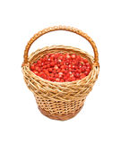 Ripe wild strawberry in a wicker basket. On a white background Royalty Free Stock Images