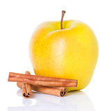 Ripe yellow apple with cinnamon sticks Stock Photography