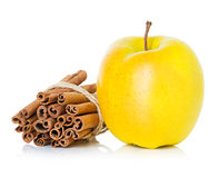 Ripe yellow apple with cinnamon sticks Royalty Free Stock Images